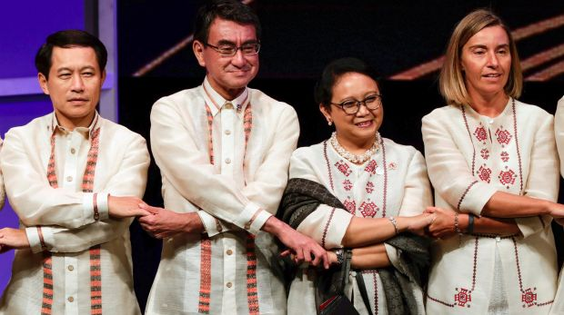 From left, Laos' Foreign Minister Saleumxay Kommasith, Japan's Foreign Minister Taro Kono, Indonesia's Foreign Minister ...