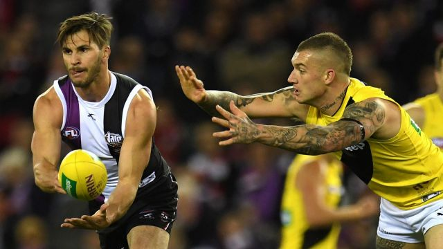 Heavy loss: Koby Stevens clears ahead of Richmond's Dustin Martin in the round 16 contest that sent the Tigers crashing ...