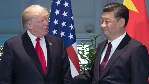 Chinese President Xi Jinping, right, will host US President Donald Trump, left, in Beijing later this year. Here the two ...