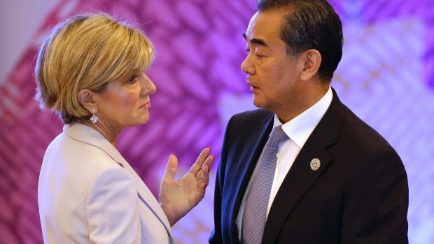 Chinese Foreign Minister Wang Yi, right, talks with his Australian counterpart Julie Bishop at the ASEAN forum in the ...