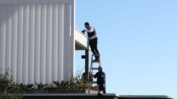 Police search the gutters of John Ibrahim's Dover Heights home.