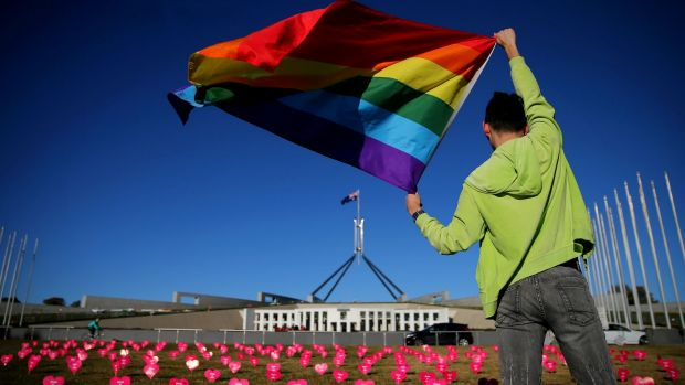 Marriage equality advocate Russell Nankervis with the rainbow flag during a 'Sea of Hearts' event in support of marriage ...