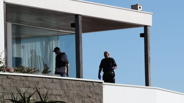 Police search John Ibrahim's clifftop home in Dover Heights on Tuesday.