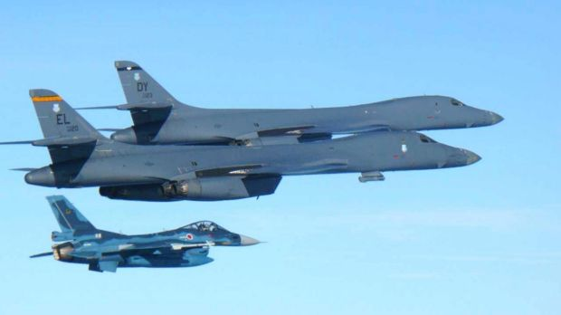US Air Force B-1B bombers top fly with a Japan Air Self Defence Force F-2 fighter jet over Japan's southern island