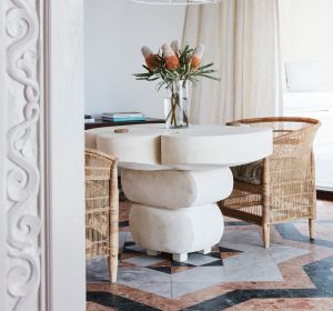 STYLING TIP: Raw linen and hand-woven rattan sit alongside Venetian plaster finishes and lighting at Rae's On Wategos.