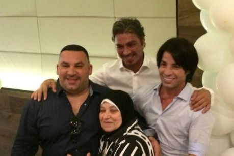 Michael, John and Fadi Ibrahim with their mother.