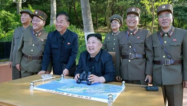 Kim Jong Un, centre, watches the test launch of missile at an undisclosed location in North Korea.