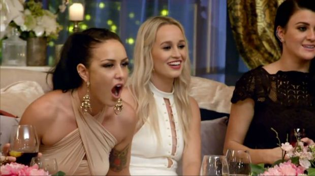 Sian's reaction when Laura returned with a rose.