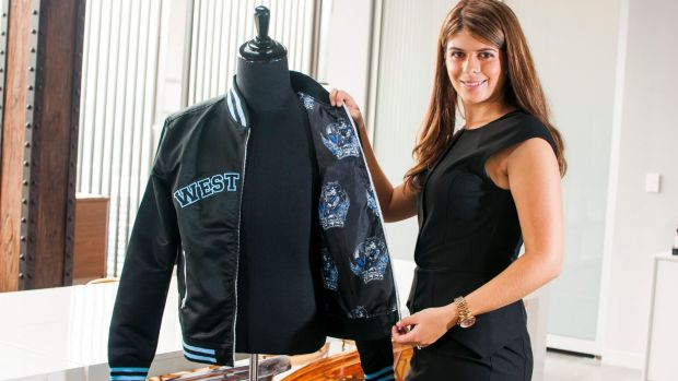 Elyse Daniels, founder of Exodus Wear, shows off one of the company's bomber jackets.