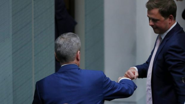 Opposition Leader Bill Shorten fistbumps his adviser Ryan Liddell after a speech to the House of Representatives on Thursday.