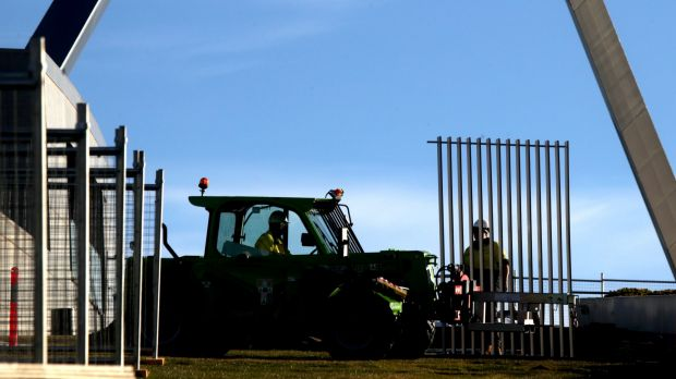 Workers installed the first section of a 2.6m high security fence at Parliament House.