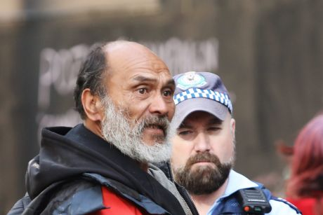 Leader of tent city Lanz Priestly talks to police at Martin Place.