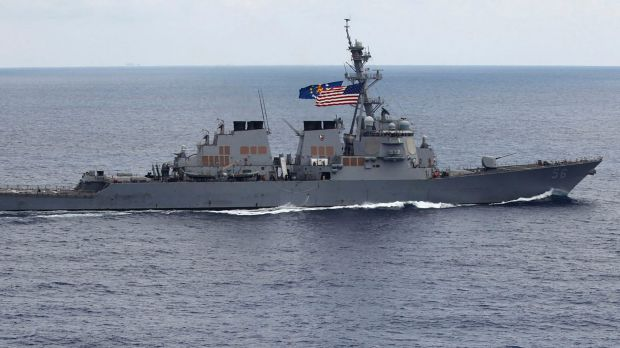 The USS John S McCain destroyer cnducted a fereedom of navigation patrol in disputed waters of the South China Sea on ...