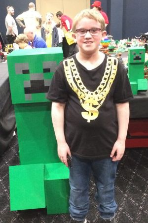 Oscar Williams, 11, of Florey with the massive Minecraft Lego creeper at Brick Expo at the Hellenic Club.