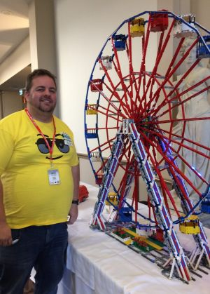 Monash public servant Russell Murphy with his 4000-piece Lego ferris wheel.