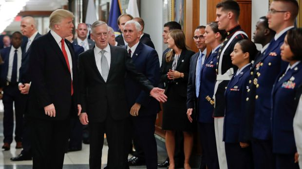 President Donald Trump and Vice-President Mike Pence with Defence Secretary Jim Mattis, centre, greet military personnel ...