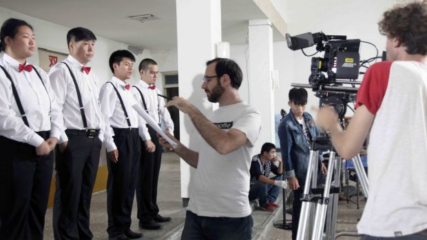 Sam Voutas directing a scene in China.