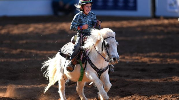 Seven-year-old Dekota Caban and her Shetland pony, Biscuit, at the Mt Isa Rodeo.