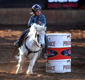 Seven-year-old Dekota Caban competes in the Junior Barrel Racing competition at the Mt Isa Rodeo.