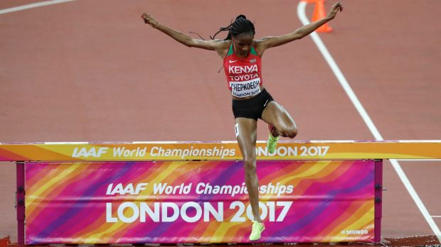Kenya's Beatrice Chepkoech crosses the water jump in the women's 3000m steeplechase final, after initially sailing past it.