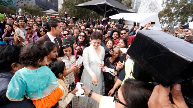 Crowds flock to see Aishwarya Rai Bachchan, who hoisted the Indian national flag ahead of the Independence Day on Tuesday.