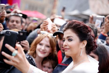 Aishwarya Rai Bachchan stops for a selfie with fans at Melbourne's Federation Square.