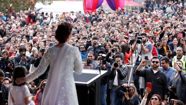 Thousands of screaming fans packed out Federation Square to get a glimpse of their the Bollywood star, on stage with her ...