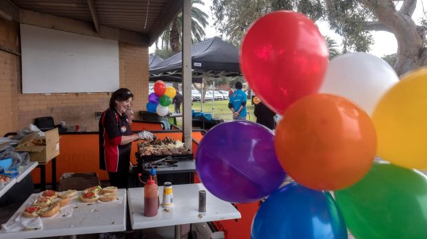 Even the barbecue was adorned with rainbow-hued balloons.