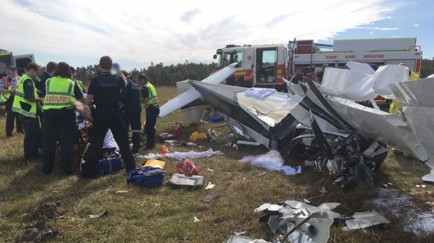Emergency service crews at the aftermath of the Caloundra plane crash.