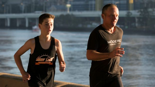 Mr Biszczak finishing the final five kilometres of his Million Dollar Run with EB sufferer Lachlan Woodward at South Bank.
