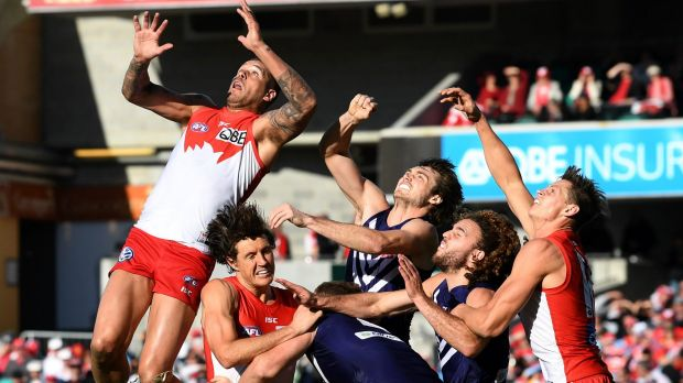 Buddy Franklin leaps high for a mark.