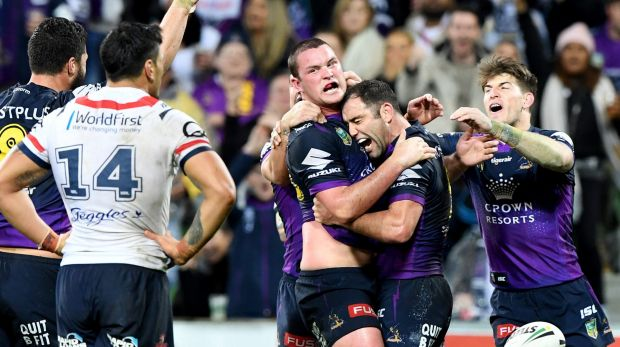 Storm's Joe Stimson is hugged by captain Cameron Smith after his match-winning try against the Roosters.