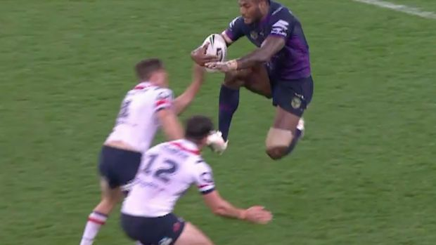 'How do you comment on that?' Melbourne's Suliasi Vunivalu leaps with his knees at the Roosters defenders.