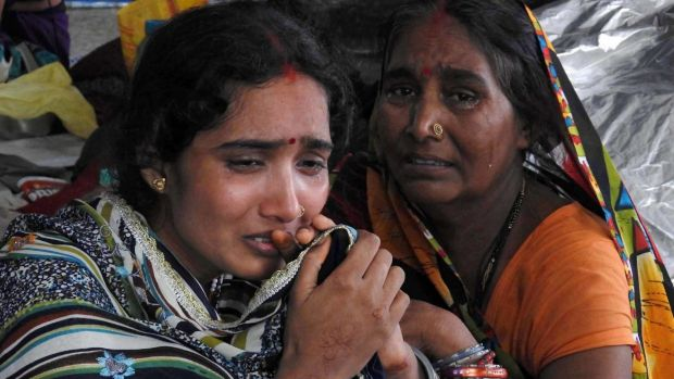 Relatives mourn the death of a child at the medical college hospital in Gorakhpur,.
