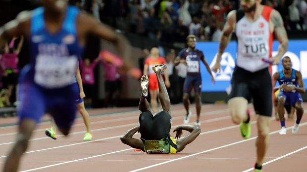 Shot down: Jamaica's Usain Bolt drops the baton as he pulls up injured in the final of the Men's 4x100m relay during the ...