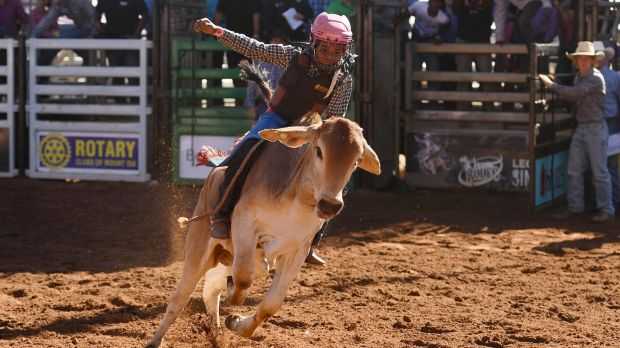 Ten-year-old Peter Gregory jnr competes in the poddy ride final at the Mount Isa Mines Rotary Rodeo.