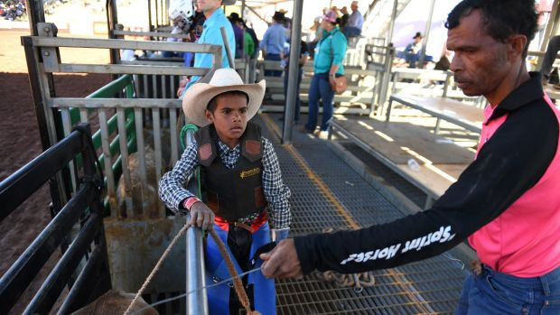 Peter Gregory jnr with his father Peter snr as he prepares to compete at the rodeo.
