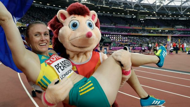 Sally Pearson celebrates with mascot Hero the Hedgehog.