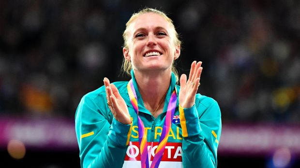 Sally Pearson celebrates her incredible victory on the podium.