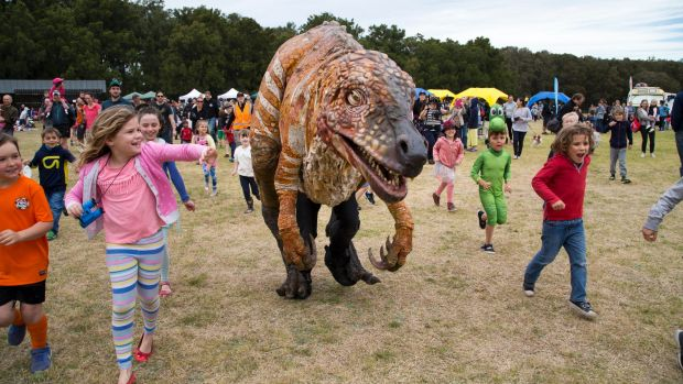 """Children and dinosaurs alike enjoyed the warm weekend weather for """"Science in the Swamp"""" at Centennial Park."""