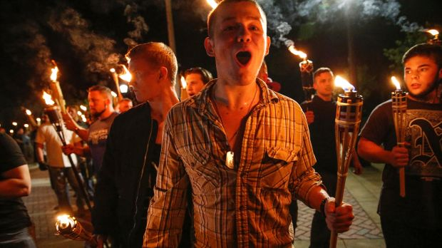White nationalist groups march with torches through a univeristy campus in Charlottesville.