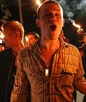 White nationalist groups march with torches through a university campus in Charlottesville.