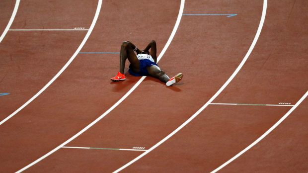 Britain's Mo Farah lies on the track after taking silver