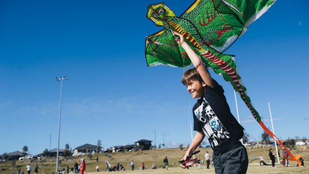 Macca Cleary, 9, of Queanbyean trying to get his kite up despite a lack of wind at Flying High in the Googong Sky on ...