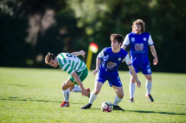 Tuggeranong United v Canberra Olympic at O'Connor Enclosed. Canberra Olympic's Adrian Macor gets past Tuggeranong's ...