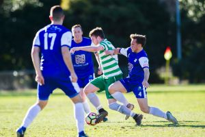 Tuggeranong United v Canberra Olympic at O'Connor Enclosed. Tuggeranong's Liam Highmore is tackled by Olympic's Daniel ...