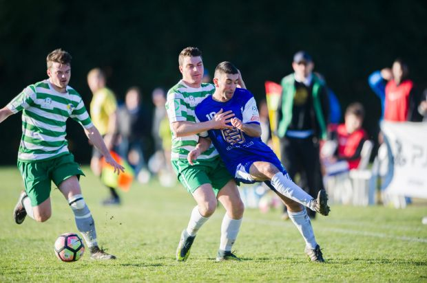 Tuggeranong United v Canberra Olympic at O'Connor Enclosed. Olympic's Stephen Domenici comes together with Tuggeranong's ...