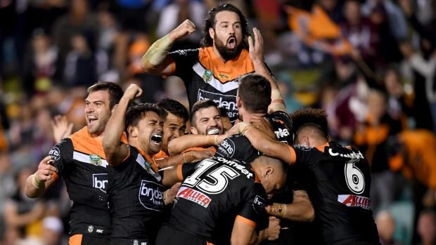 Party time: Wests Tigers players celebrate after the final try of the game.