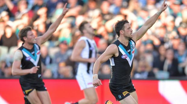 Point of interest: Port Adelaide players seek supply.