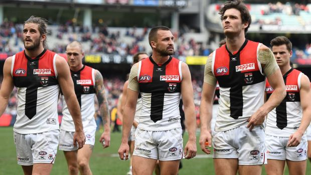 Hard yards: Saints players leave the ground after loss to Dees.